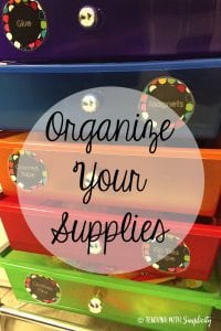 organize your supplies in cursive with a file system